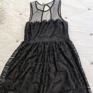 Black lace dress with sheer neckline